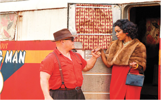 Michael Chiklis and Angela Bassett as Dell Toledo and Desiree Dupree.